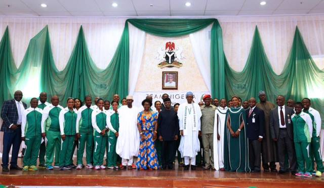 President Buhari in a group photograph with some Team Nigeria members