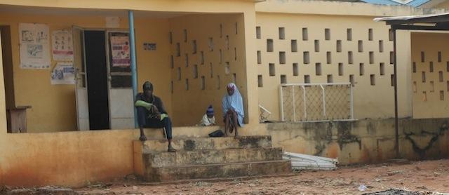 A couple with a baby awaiting service at General Hospital, Koton-Karfe