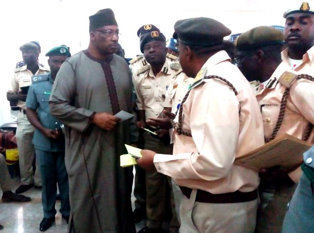 Interior Minister, Abdulrahman Dambazzau, with top officers of the Nigerian Immigration Service at the Kaduna International Airport on Thursday
