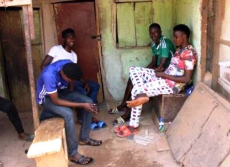 Sabi Isah with his roomates in front of their house in the Mabushi slum