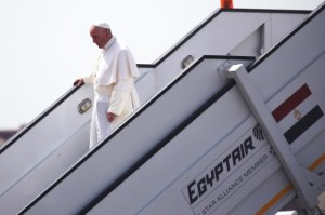 Pope Francis disembarks after arriving at Cairo International airport
