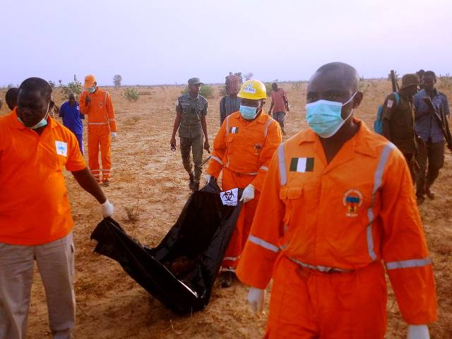 Emergency workers working on Friday at the scene of suicide attack at University of Maiduguri