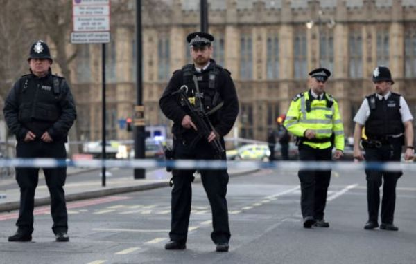 Armed officers outside Westminster Bridge after the terror attack in which 5 people, including an unarmed policeman was killed