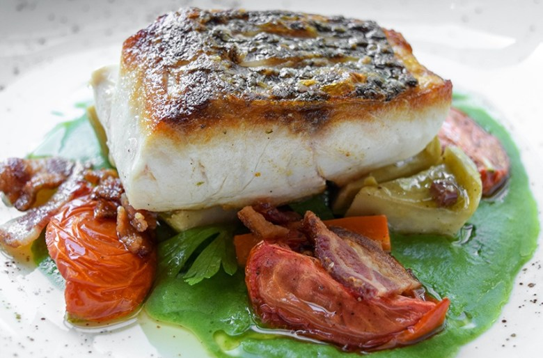 Roasted sea bass with artichokes and confit tomatoes Chef Alex Stratta
