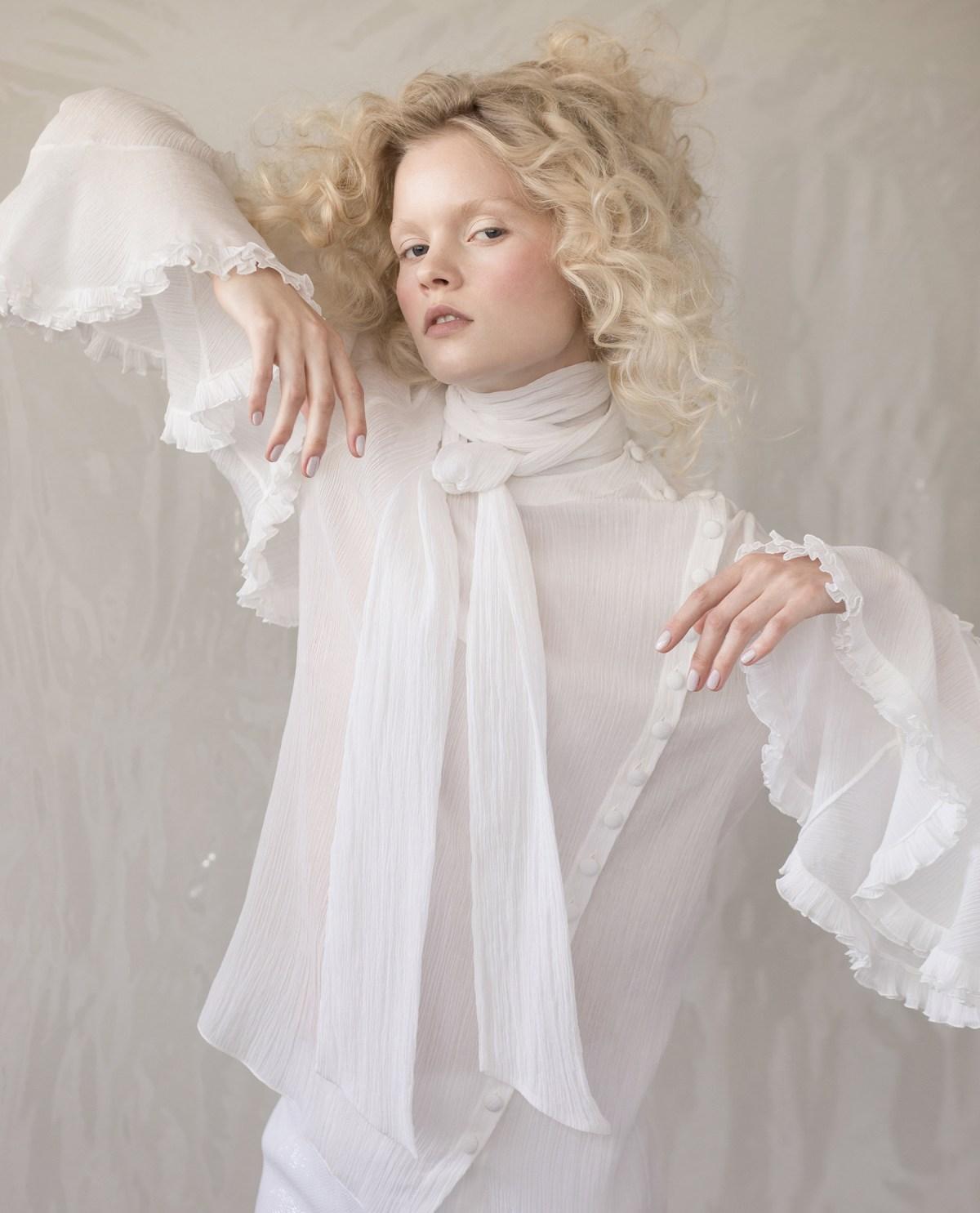 Blond model wearing a white Chloé blouse