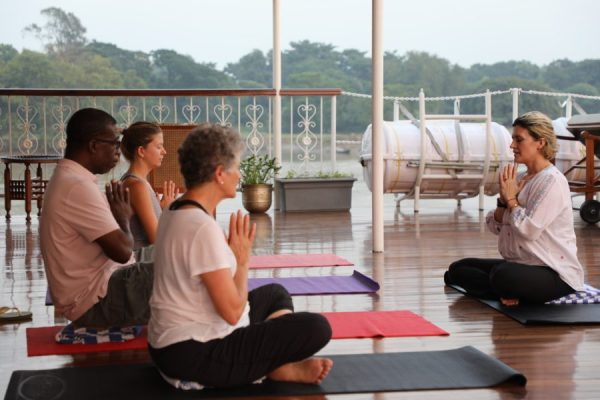 Yoga on the Ganges during a river cruise in India