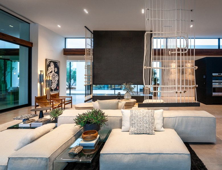 ICONIC HAUS Living Room by IMI Design
