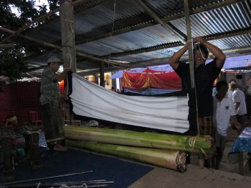The stage is constructed anew each night using bamboo and banana logs. The family hosting the show also sets up a temporary pavilion for the audience.