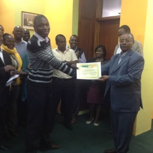 Tonny Ashibwe receiving a certificate of completion