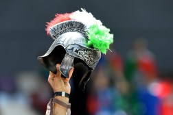An Italy supporter holds up a mockup of a ancient Roman helmet with plumes in the Italian colours ahead the Euro 2016 match between Italy and Sweden at the Stadium Municipal in Toulouse on June 17, 2016. (AFP/Pinto)