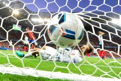 Turkey's goalkeeper Volkan Babacan lays in his goal as Spain's forward Alvaro Morata scores the 1-0 during the Euro 2016 match between Spain and Turkey at the Allianz Riviera stadium in Nice on June 17, 2016.