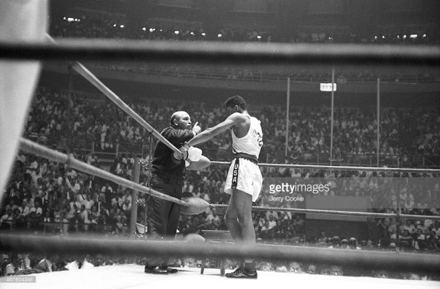 Cassius Clay in his corner with team coach Julius Menendez during Men's Light-Heavyweight Gold Medal bout vs Poland Zbigniew Pietrzykowski at Palazzo dello Sport. Rome, Italy Sept 5, 1960. (Jerry Cook/Getty Images)