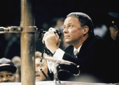Frank Sinatra, shooting the Frazier versus Ali fight for LIFE magazine, holding his camera ringside at Madison Square Garden in New York, March 8, 1971.