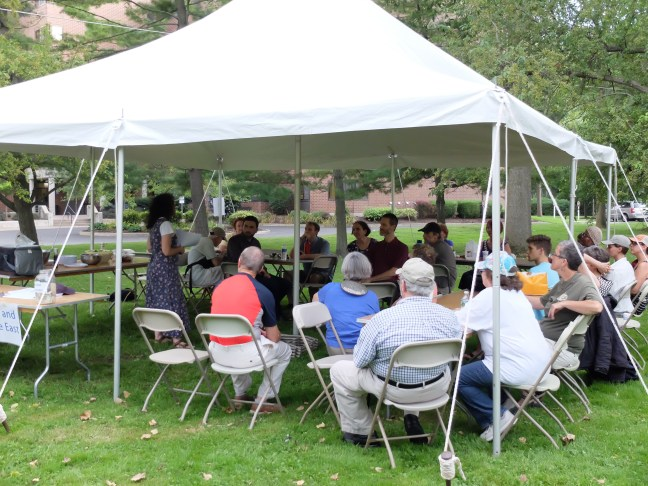 Participants under the tent, during discussion