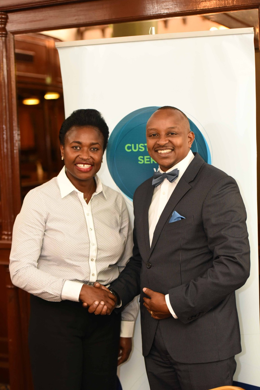 Incoming-Board-Member-Jannet-Atika-shakes-hands-with-outgoing-board-member-Job-Njiru