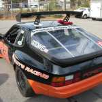Orange and black ricer car with rear wing