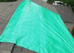 Putting tarp on a roof