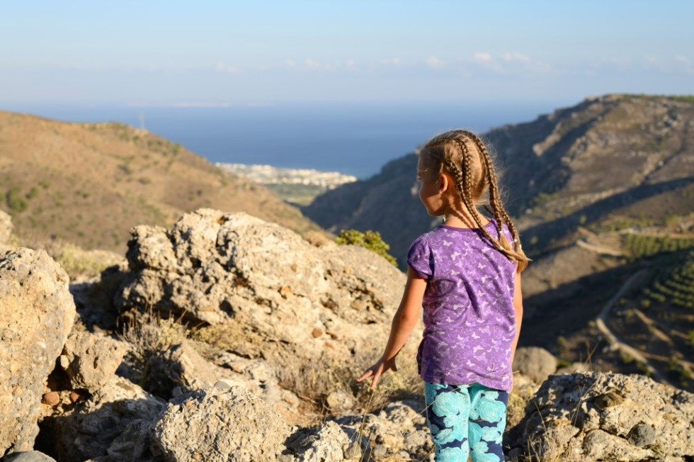 Best Greek Girl Names (With Meanings) For Your Little Goddess, girl hiking in mountains of Greece