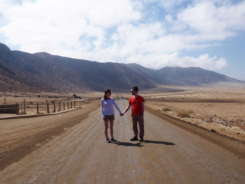 Us posing on the road between Chañaral, Chile and Pan de Azúcar National Park