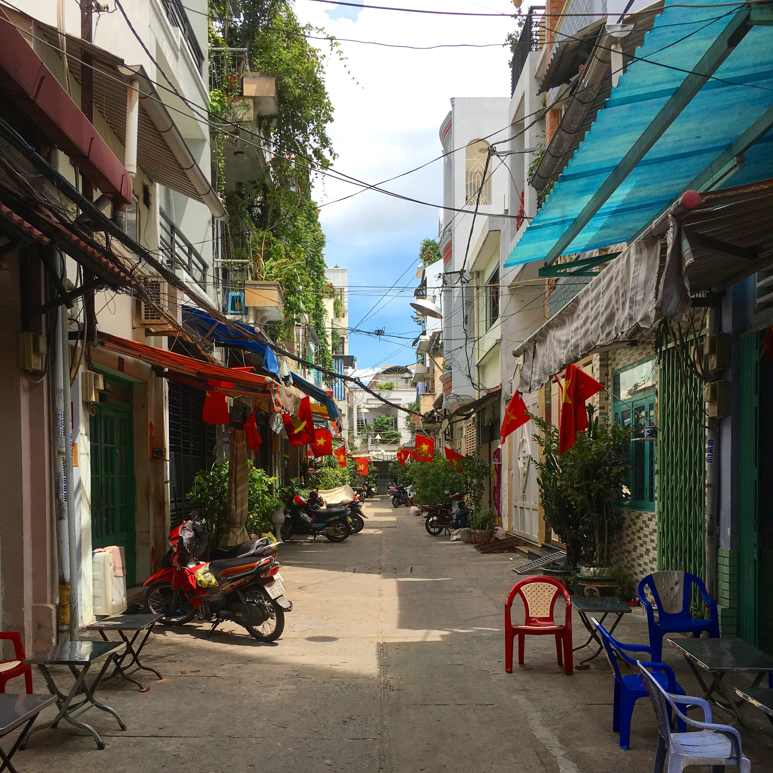 An alley in Ho Chi Minh City decked out with flags for Vietnam's Independence Day celebration