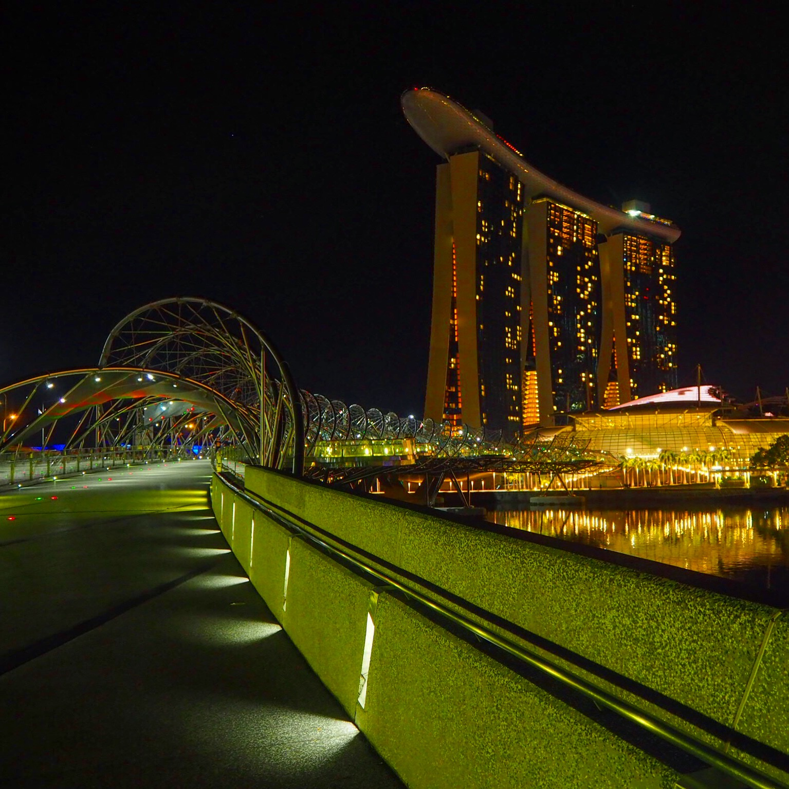 Walking across the Helix Bridge in Singapore at 1:00 a.m.