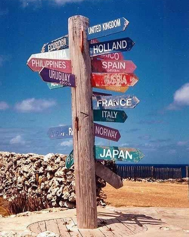 Distance signs that list miles remaining to cities