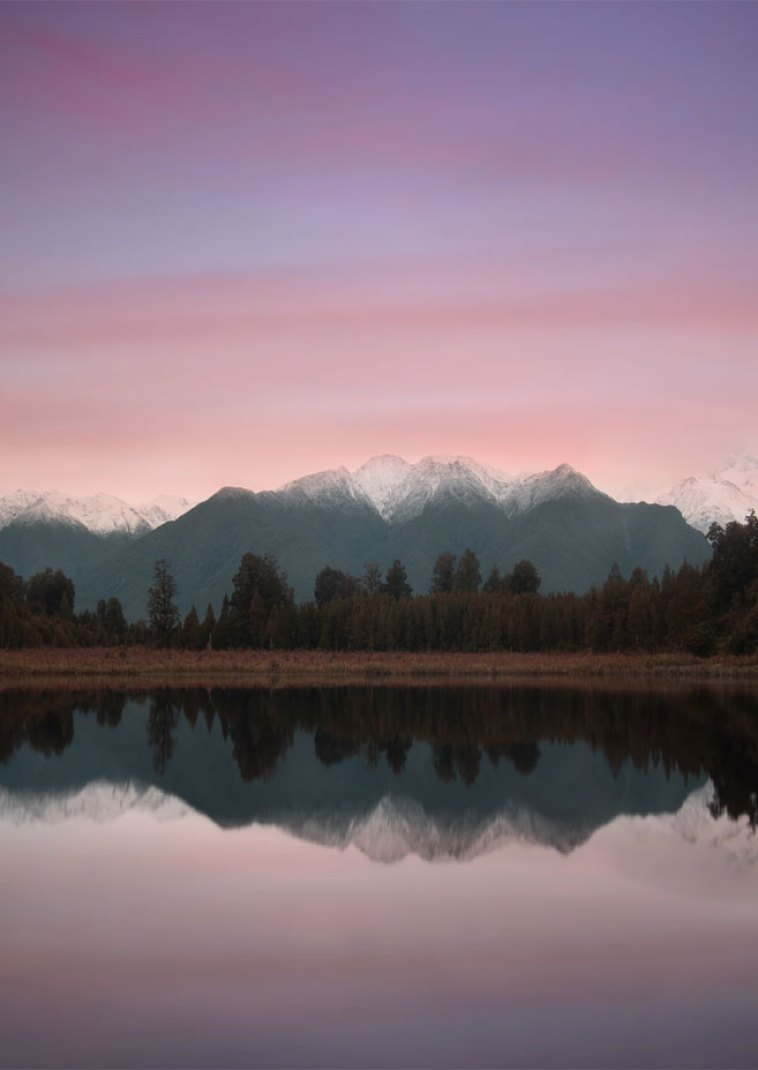Stunning landscape and reflect of mountains , mauve sky