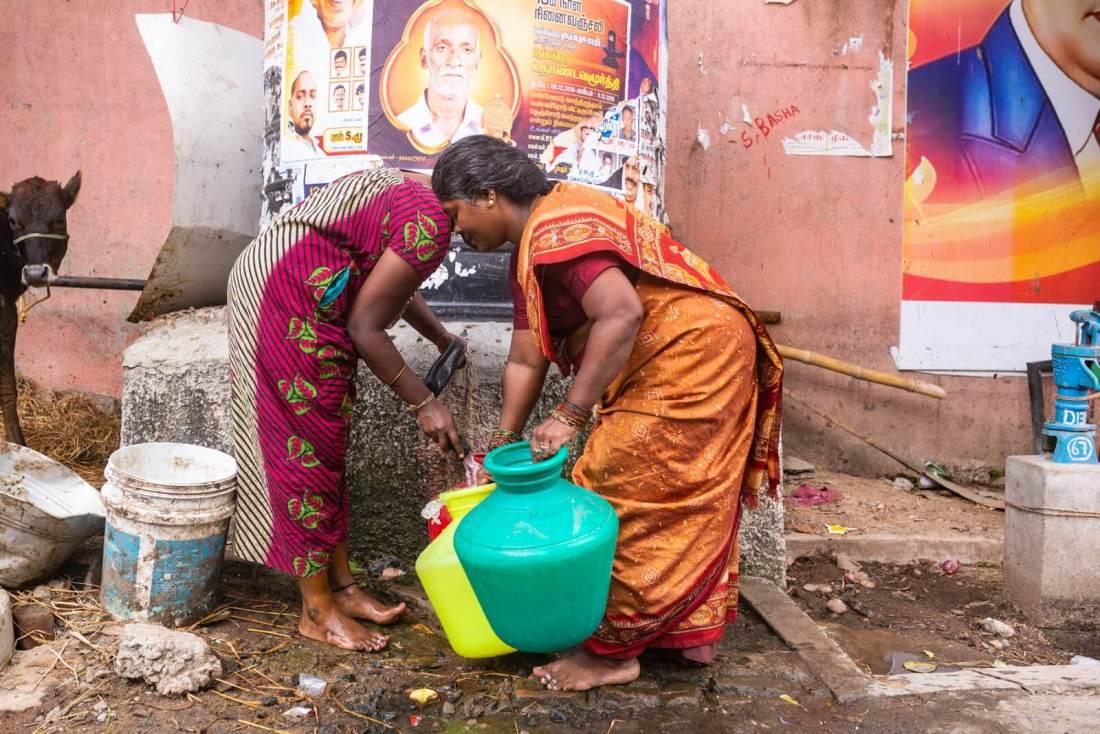 Kannika Arumugam collecting water from the local pump near her home in Chennai, India. Photo credit: Gayatri Nair