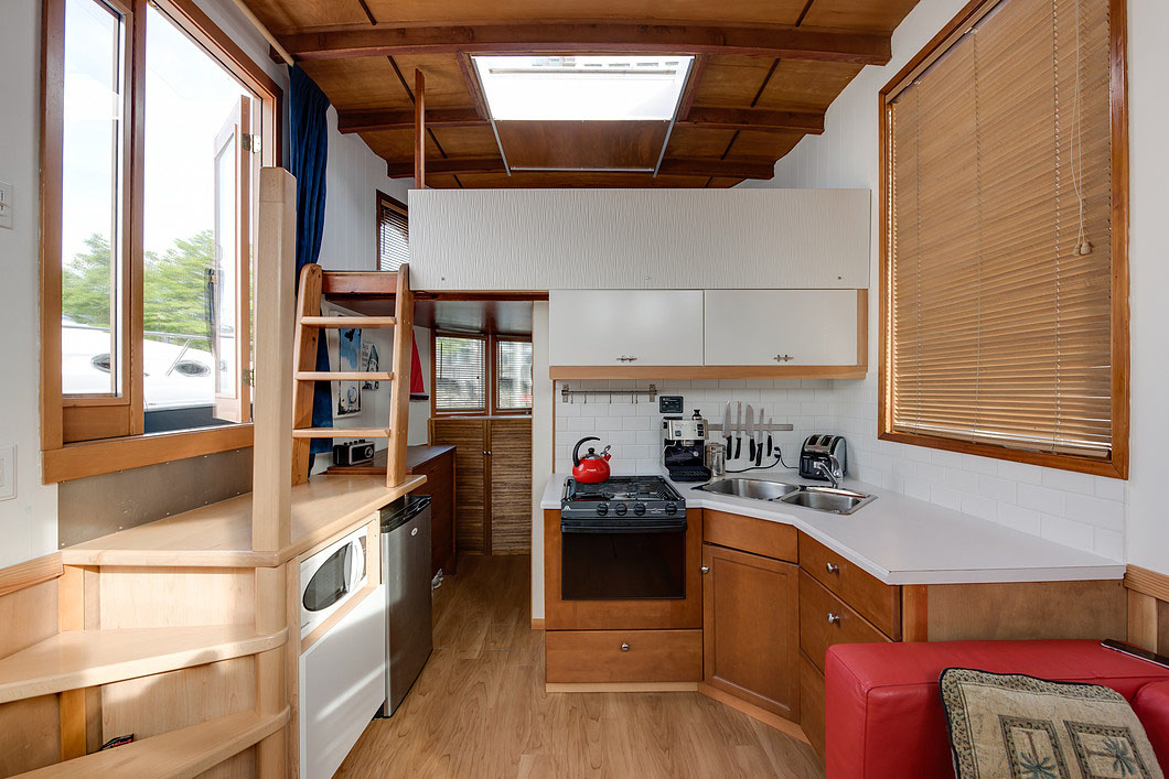 Cute Houseboat Provides Affordable Living With A Unique