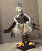 Lady Peacock - This is a cloth doll with wired arms/legs for poesability. She now resides at the Uncanny Gallery.