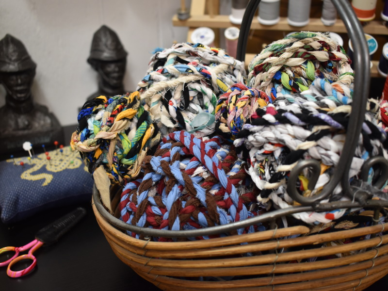 A basket of fabric twine balls