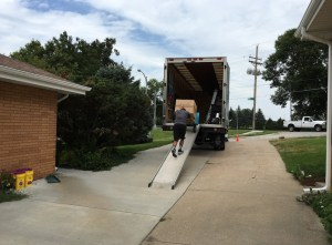Like Sisyphus pushing the boulder, these movers worked hard to get daughter to her new place.