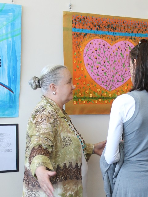 Karen Robinson standing by her painting 'Heart of Treasured Memories' at the Reflections Exhibition 2015 Northcote Townhall NB All images are protected by copyright laws