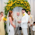 Yellow flowers behind ceremony with Austin wedding officiant