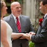 Bride and groom exchange rings at Austin wedding