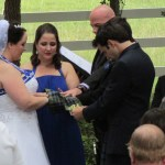 Austin wedding officiant praying for bride and groom during hand blessing ceremony at Angel Springs