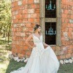 Bride in front of clay block silo temple texas