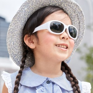 Young girl wearing Tiny Tots II - IE5635, White frame with adjustable headband included
