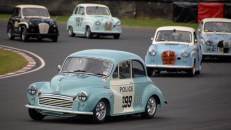 HRDC Allstars /ACD/ASC competiitor and singer songwriter Chris Rea races his 1952 Morris Minor in Police livery 999 around Quarry Corner on Sunday.