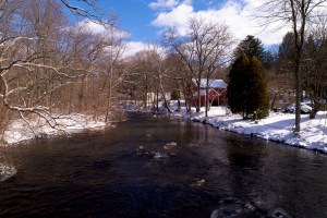 house on river drone photo
