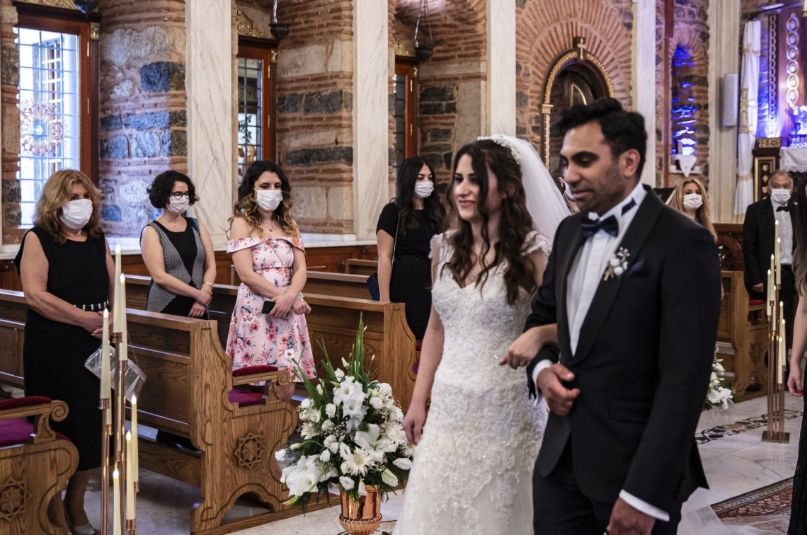 Newlyweds Iskender and Melek Acar walk to the altar as the only people in the church not wearing masks, in Istanbul, Turkey, June 14, 2020. (DHA Photo)