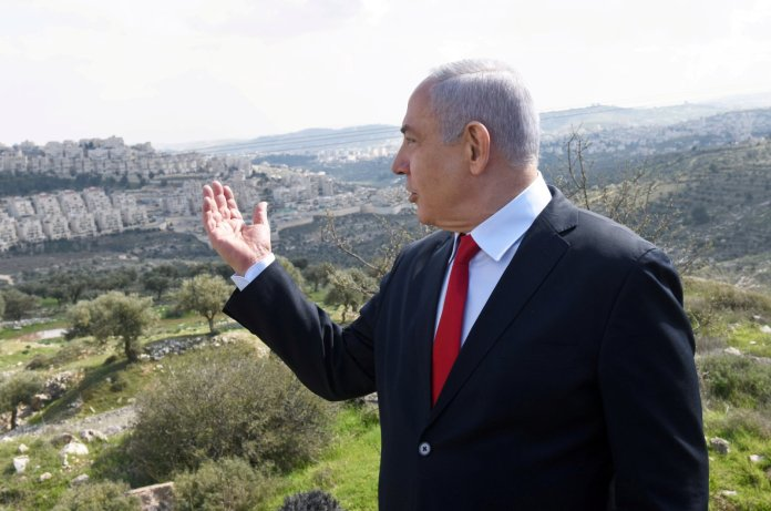 Israeli Prime Minister Benjamin Netanyahu delivers a statement overlooking the Israeli settlement of Har Homa, located in an area of the Israeli-occupied West Bank, Feb. 20, 2020. (REUTERS Photo)