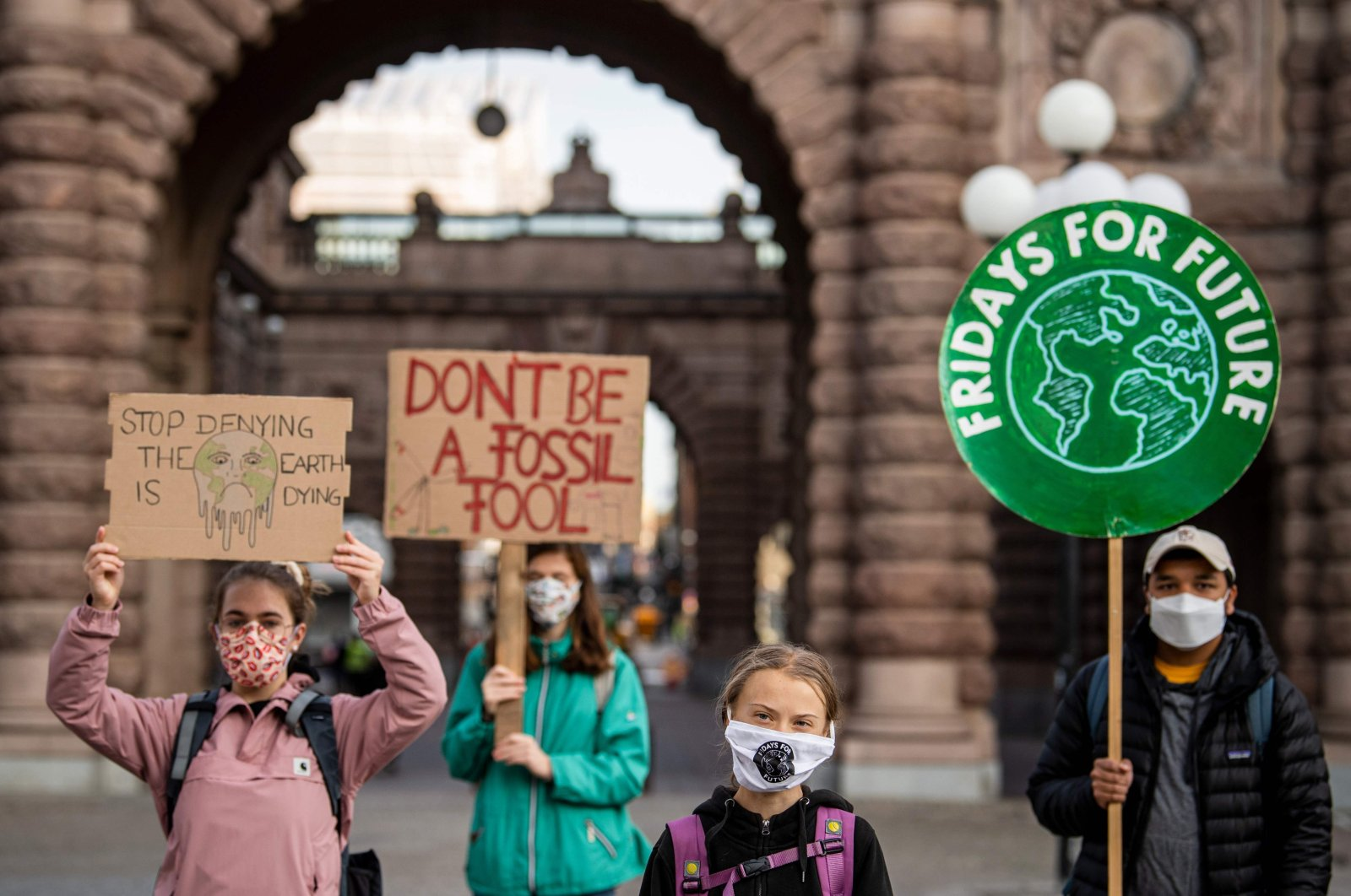 Swedish climate activist Greta Thunberg (second R) protests in front of the Swedish parliament, the Riksdagen, Stockholm, Sept. 25, 2020. (AFP Photo)