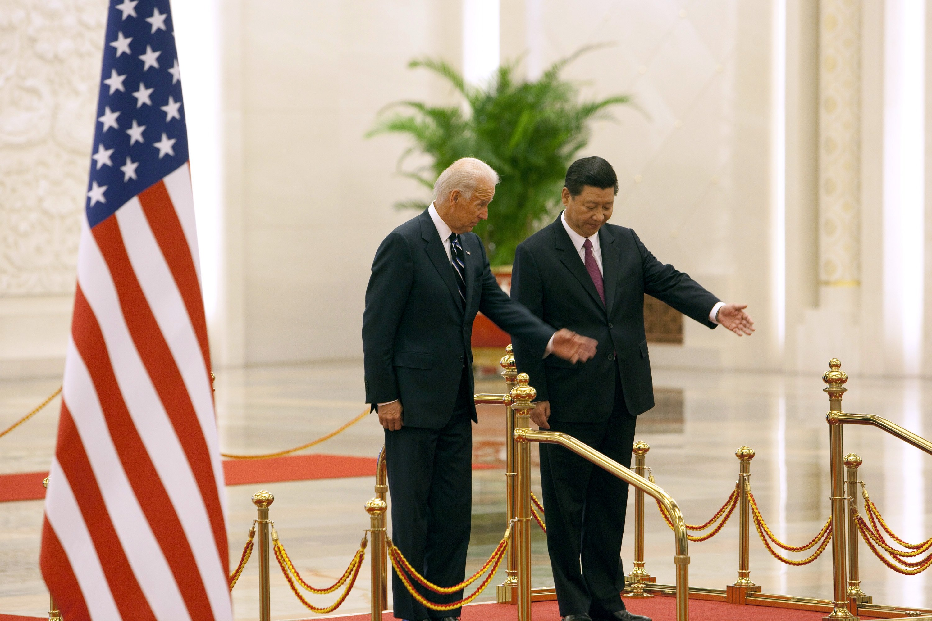 China's then Vice President Xi Jinping (R) attends a welcoming ceremony with then U.S. Vice President Joe Biden at the Great Hall of the People in Beijing, China, Aug. 18, 2011. (Photo by Getty Images)