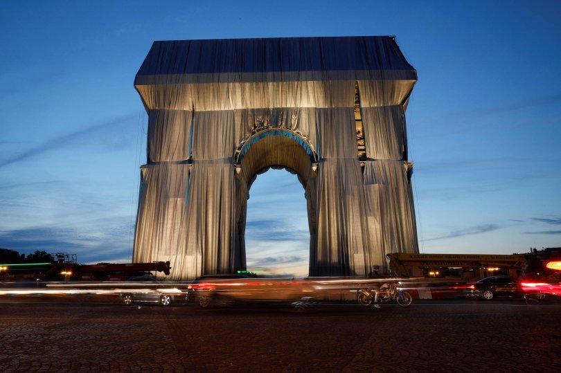 The photograph shows the Arc de Triomphe wrapped in silver-blue fabric as it was designed by the late artist Christo, Paris, France, Sept. 13, 2021 (AFP Photo)
