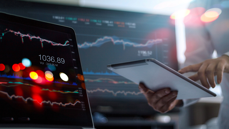 Service Unit Match - Businessman using tablet and laptop for analyzing data stock market in monitoring room background, forex trading graph, stock exchange trading online, financial investment concept. All on laptop screen are design up.