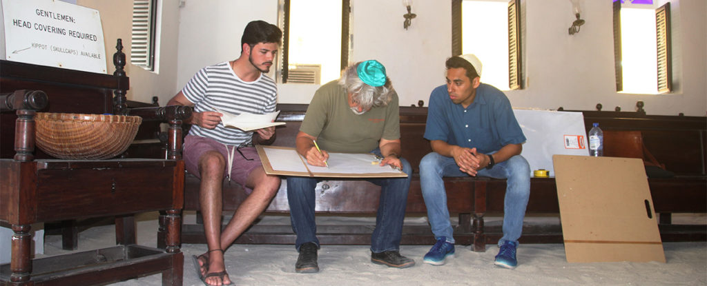 University of Miami School of Architecture Professor Jorge Hernández works on a sketch with students Hector Valdivia Arrieta (left) and Hannan Vilchis Zubizaretta (right), in the interior of the Mikve Israel Emanuel Synagogue in Willemstad, Curaçao