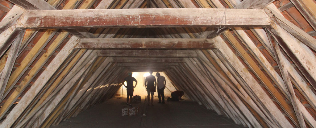 University of Miami students and researchers measure and document the inside of one of three attics in the Mikvé Israel Emanuel Synagogue in Willemstad, Curaçao