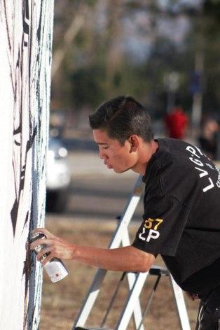 "Action shot of The Walking Giant aka Ivan Preciado. Constant on Oxygen's new show ""Street Art Throwdown"""