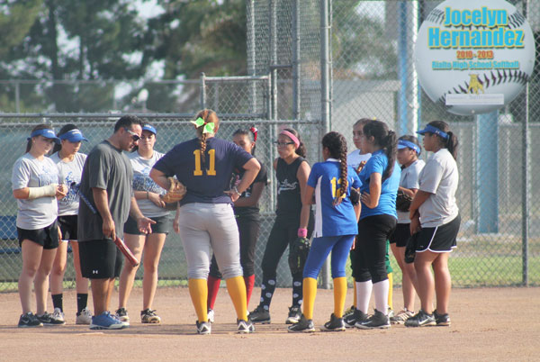 Courtesy Photo The Rialto High School Girl's Softball Team Hosted a fundamentals clinic on August 21, 2015. (Above) The girls receive instructions. (Right and Below) The girls participate in catching and infield drills.